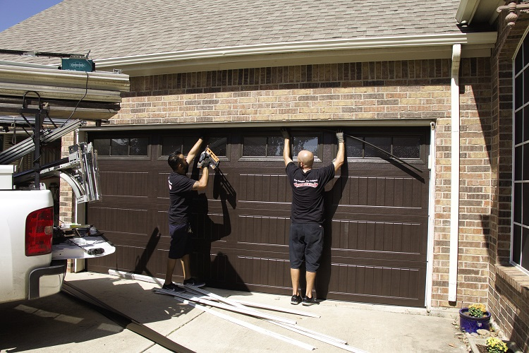 garage door experts installing a door